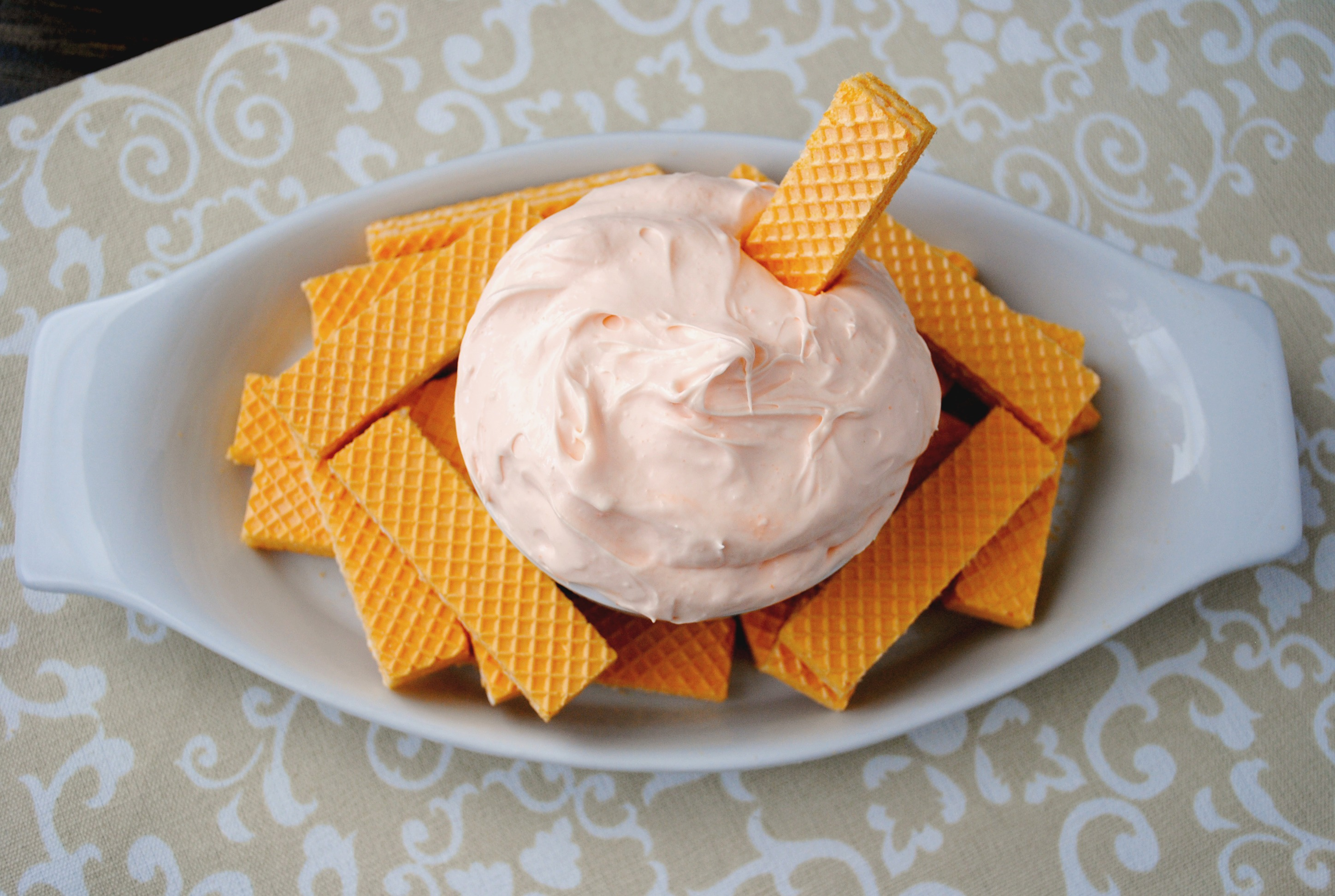 Fruit dip is a fantastic dessert. I love a cream cheese fruit dip that works with fruit or can be used as a cookie dip. Creamsicle Fluff Dip is one of those dips.