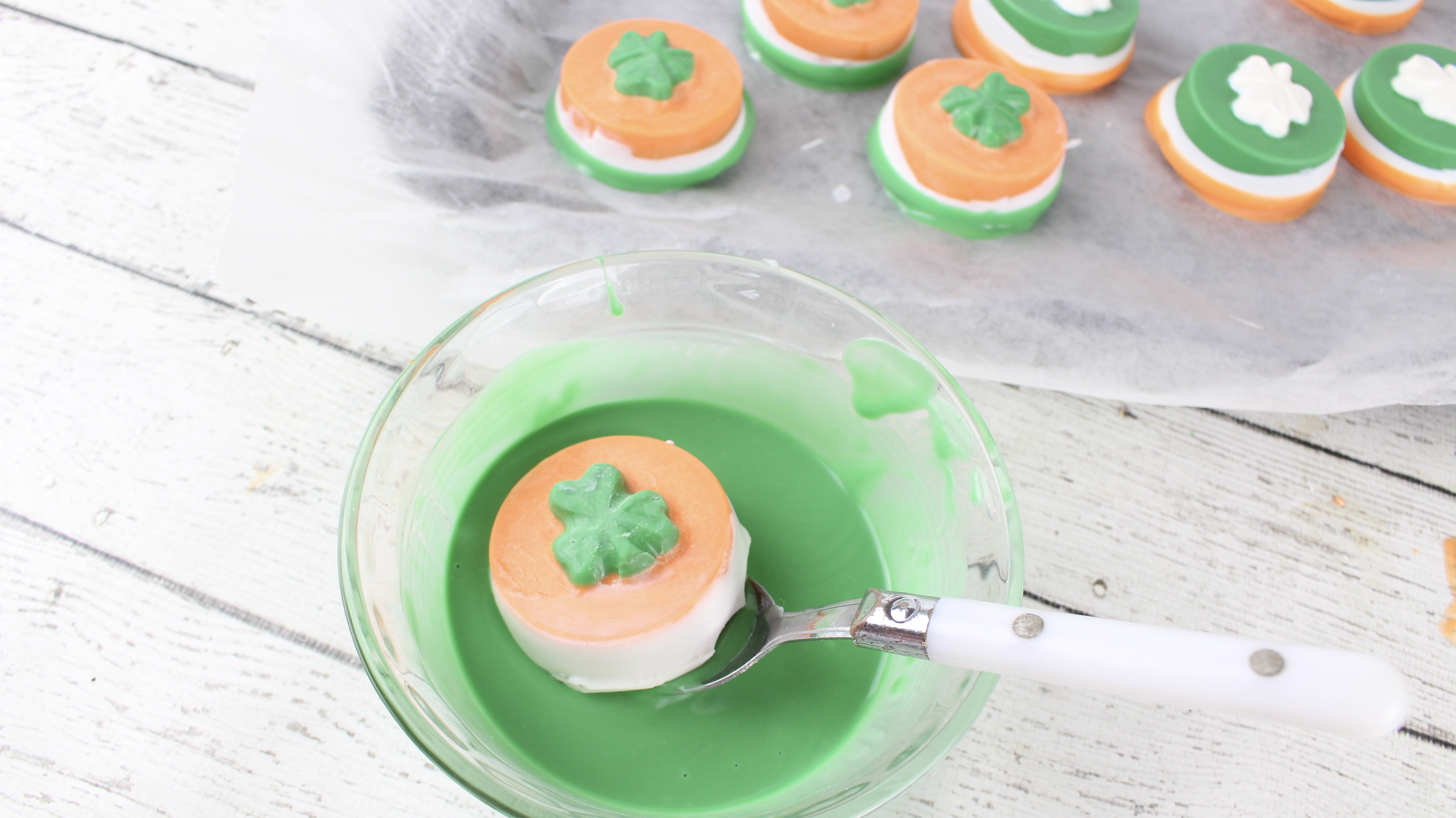 Want to make delicious St. Patrick's Day cookies? These shamrock cookies are made using Oreos and candy melts. Perfect for celebrating St. Patrick's Day.