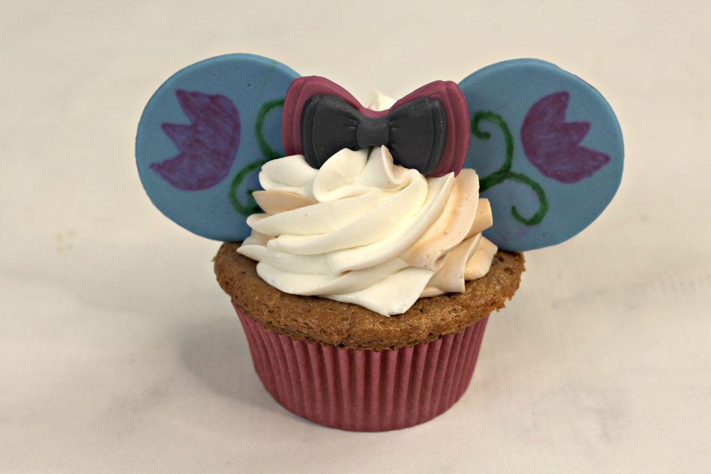 Anna Frozen cupcake with minnie ears and a bow