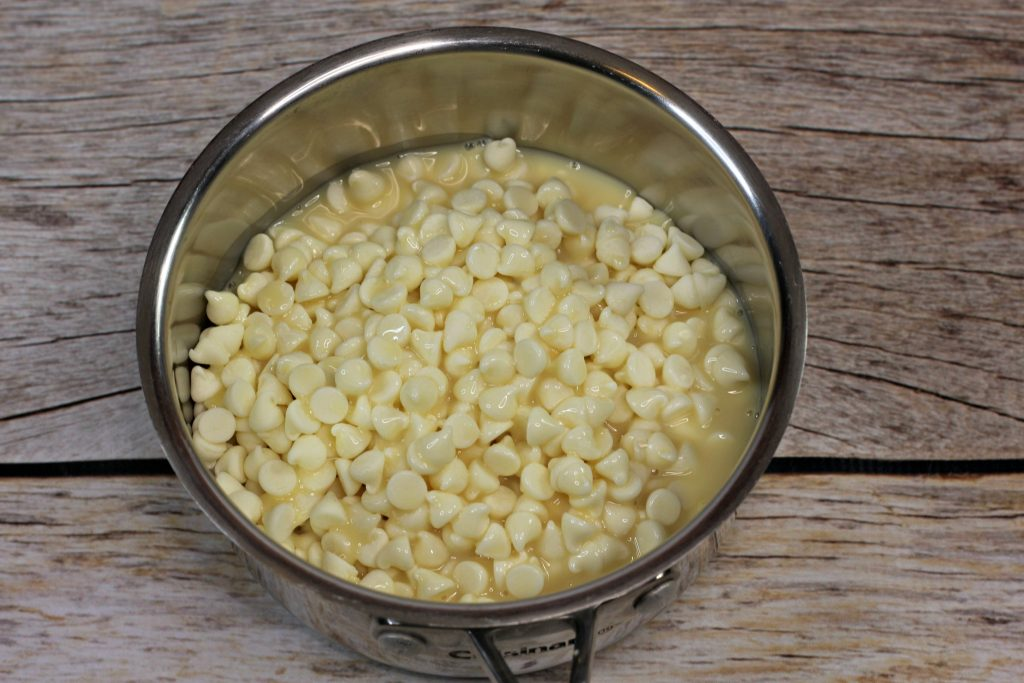 white chocolate chips and condensed milk in a bowl