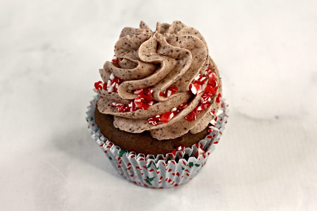 Oreo cupcakes with chocolate frosting and candy cane pieces