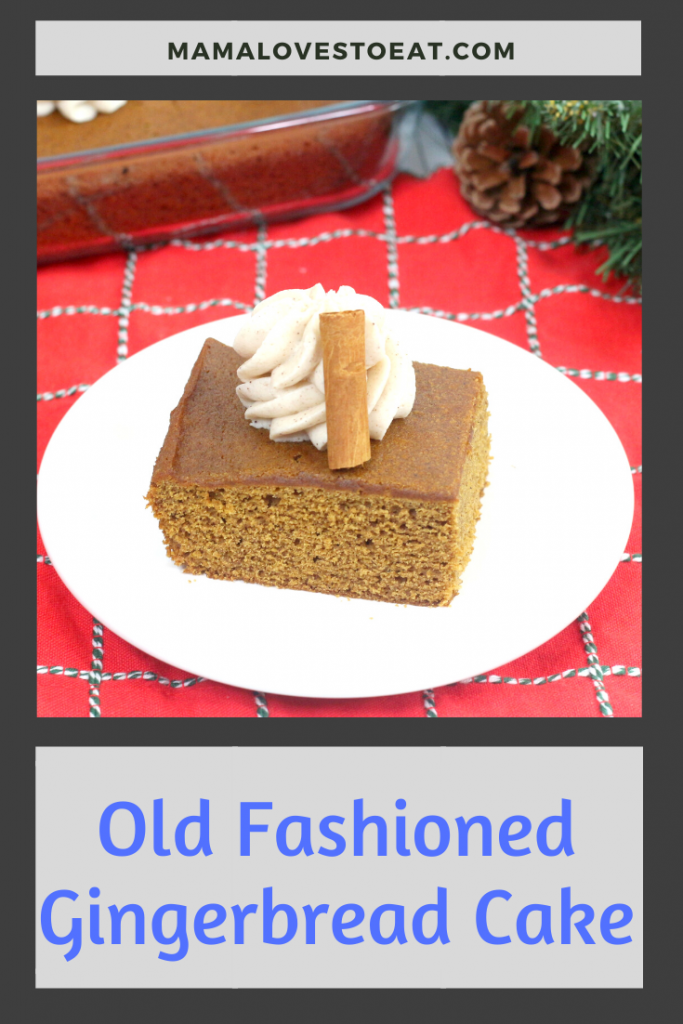 old fashioned gingerbread cake on a white plate with a red napkin