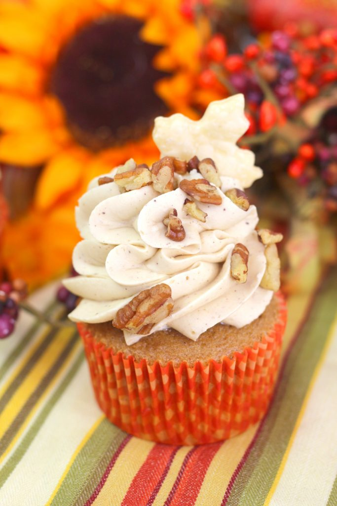 pecan pie cupcakes with frosting on top