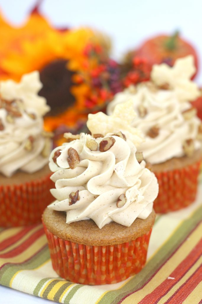 pecan pie cupcakes on a striped napkin