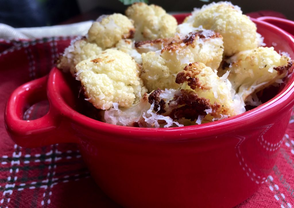 cauliflower in the oven in a red bowl